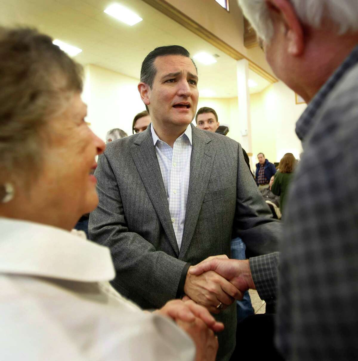 U.S. Sen. Ted Cruz, R-Texas, greets Sally, left, and Gil Priestley of Lee, N.H. during a Strafford County Republican Committee Chili and Chat on March 15.