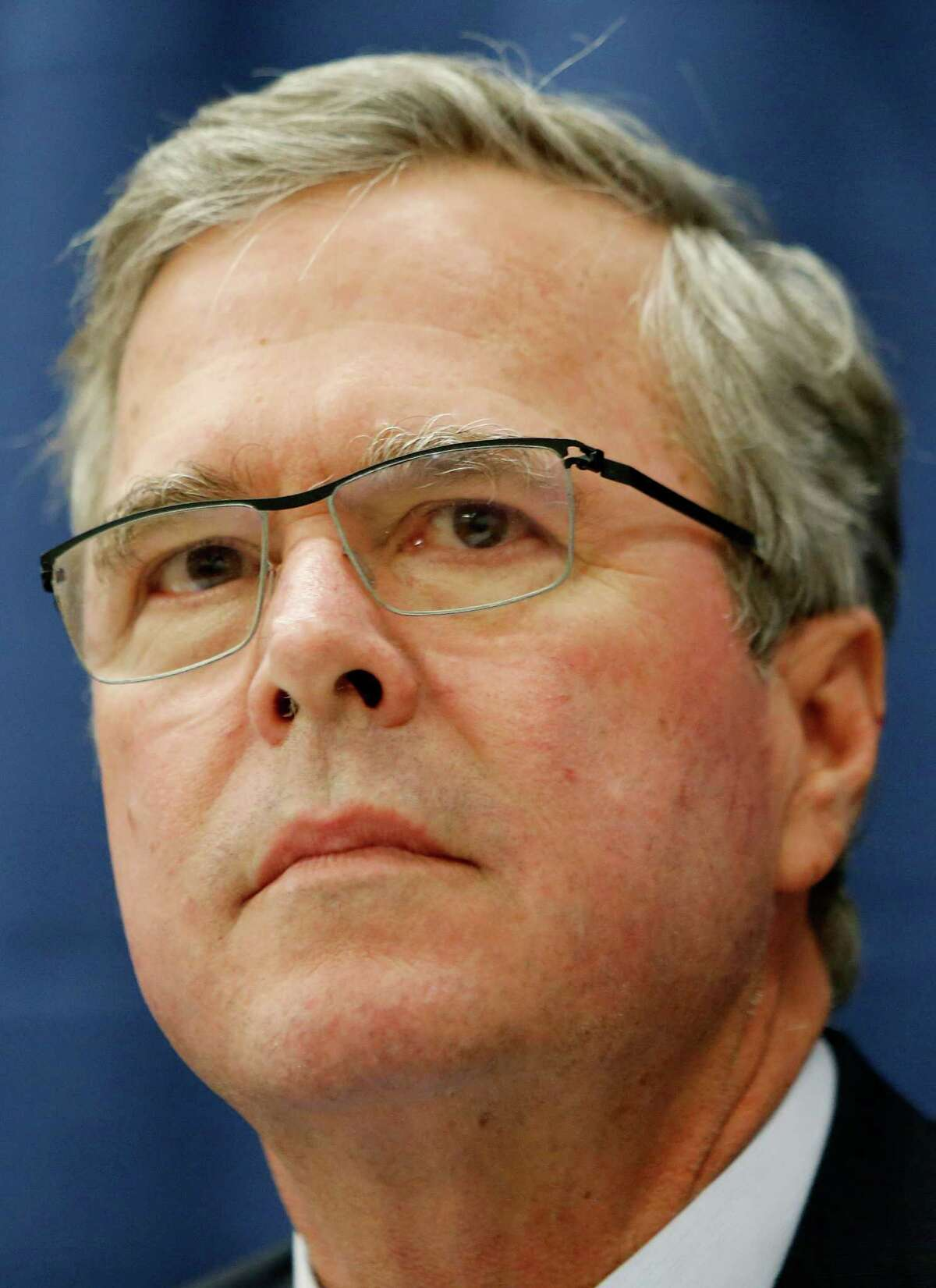 Former Florida Gov. Jeb Bush waits for questions during a meeting with the Nashua Chamber of Commerce, Friday, March 13, 2015, in Hudson, N.H. On his opening foray into New Hampshire for his likely campaign for the Republican presidential nomination, Bush challenged voters here to spend time learning about the issues and avoid shrill partisan sniping. (AP Photo/Jim Cole)