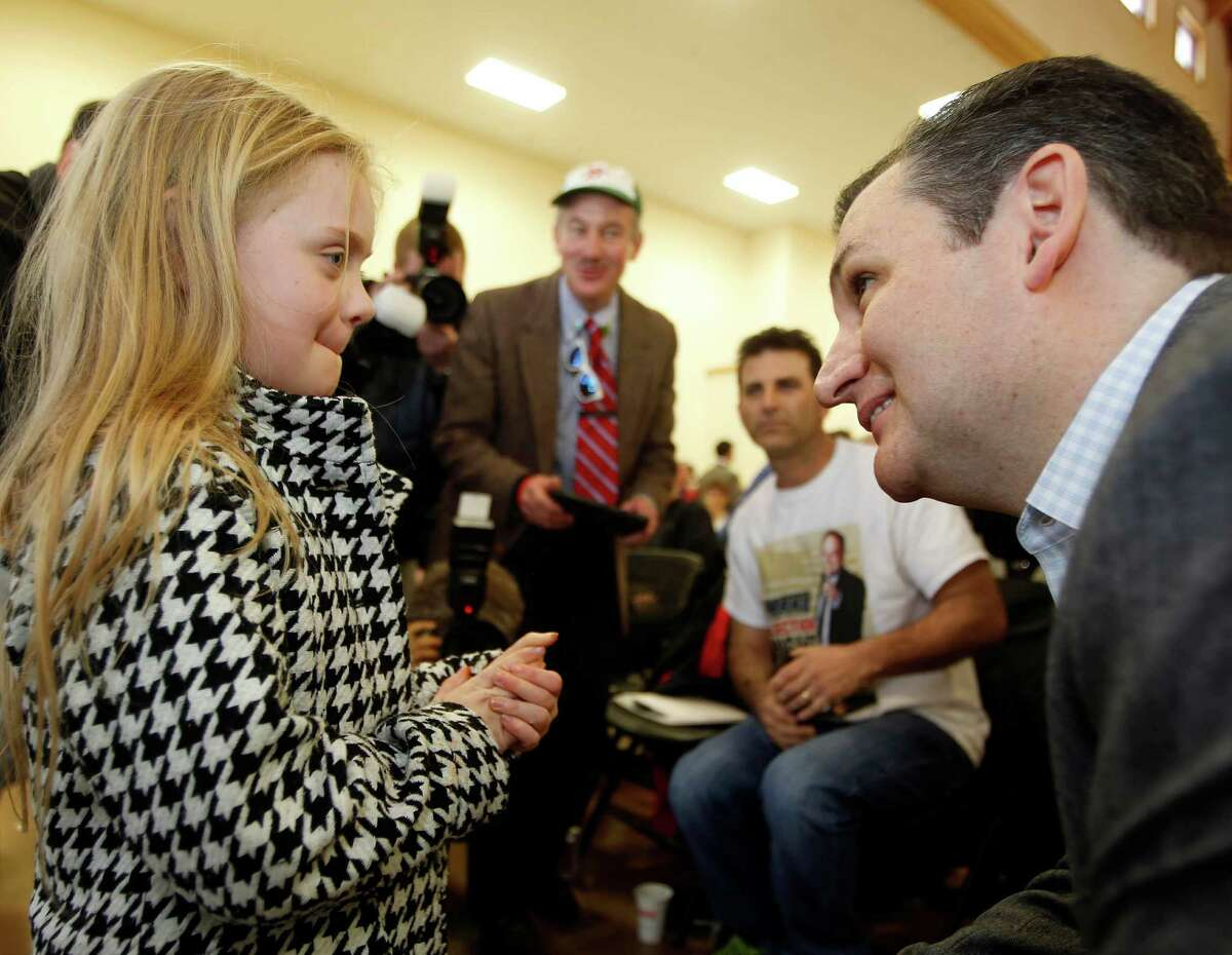 U.S. Sen. Ted Cruz, R-Texas, a tea party favorite and possible presidential candidate in 2016, speaks to Baily Ealy during a Strafford County Republican Committee Chili and Chat on Sunday, March 15, 2015, in Barrington, N.H.