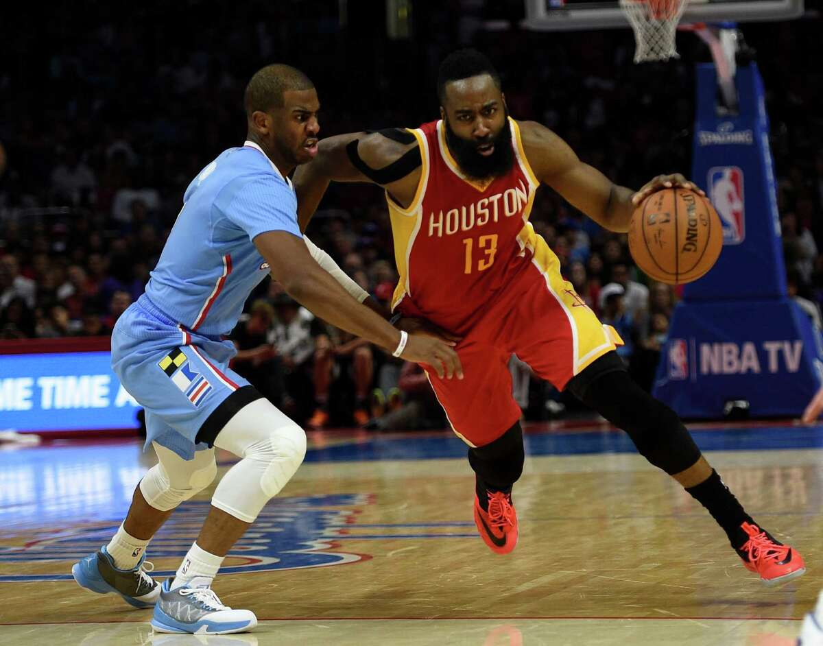 Houston Rockets guard James Harden (13) drives the ball defended by Los Angeles Clippers guard Chris Paul, left, during the fourth quarter of a NBA basketball game in Los Angeles, Sunday, March 15, 2015. The Houston Rockets won 100-98. (AP Photo/Kelvin Kuo)