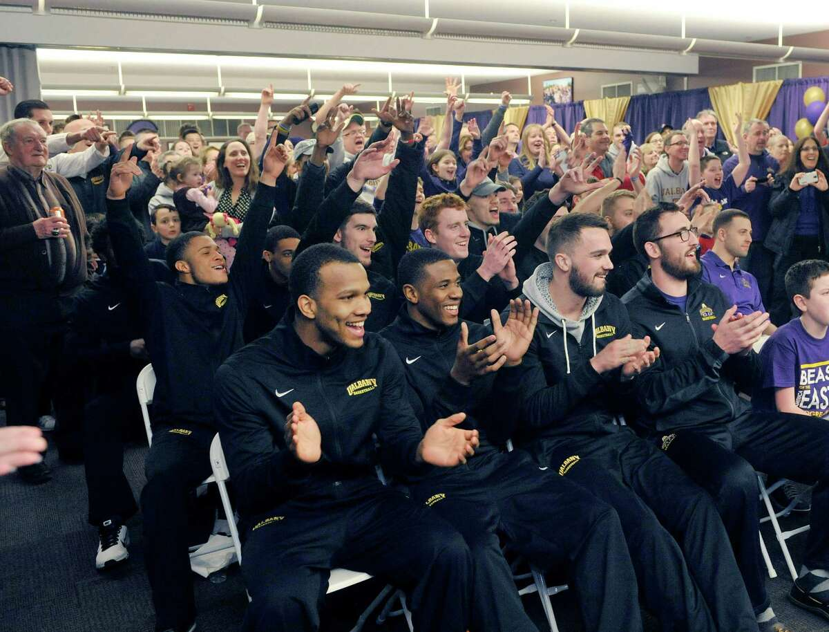 University at Albany men's basketball players, coaches and fans react on Sunday evening, March 15, 2015, in Albany, N.Y. to the announcement that they will play Oklahoma in the first round of the NCAA basketball tournament. (Paul Buckowski / Times Union)