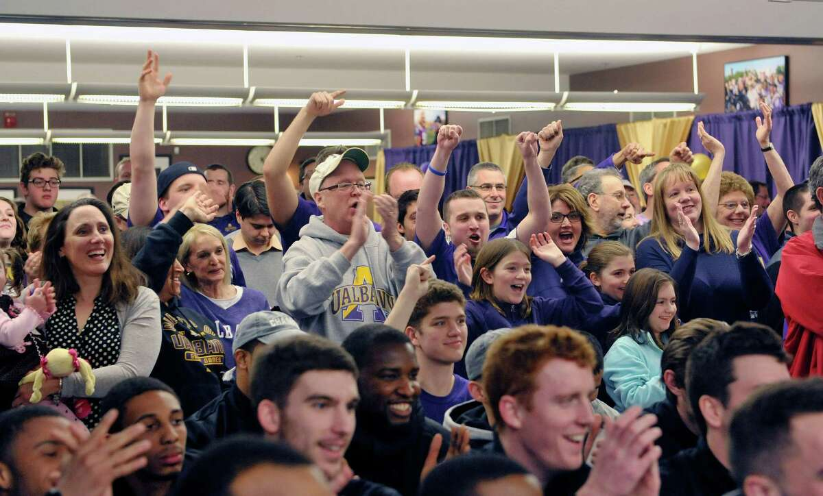 Fans of the University at Albany men's basketball program cheer on their team as they and the team members watch the NCAA selections show on Sunday evening, March 15, 2015, in Albany, N.Y. (Paul Buckowski / Times Union)