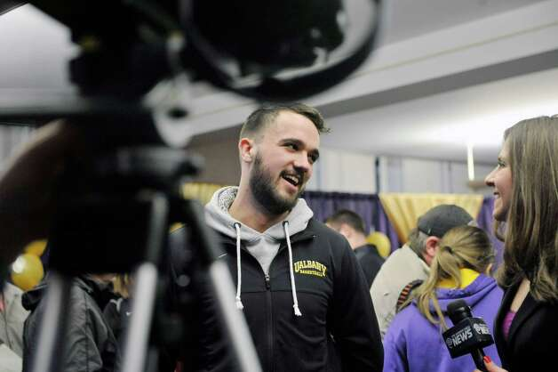 University at Albany men's basketball player, Peter Hooley, left, is interviewed by a local television sports caster on Sunday evening, March 15, 2015, in Albany, N.Y., after the team learned that they will play Oklahoma in the first round of the NCAA basketball tournament.  (Paul Buckowski / Times Union) Photo: PAUL BUCKOWSKI / 00031038A