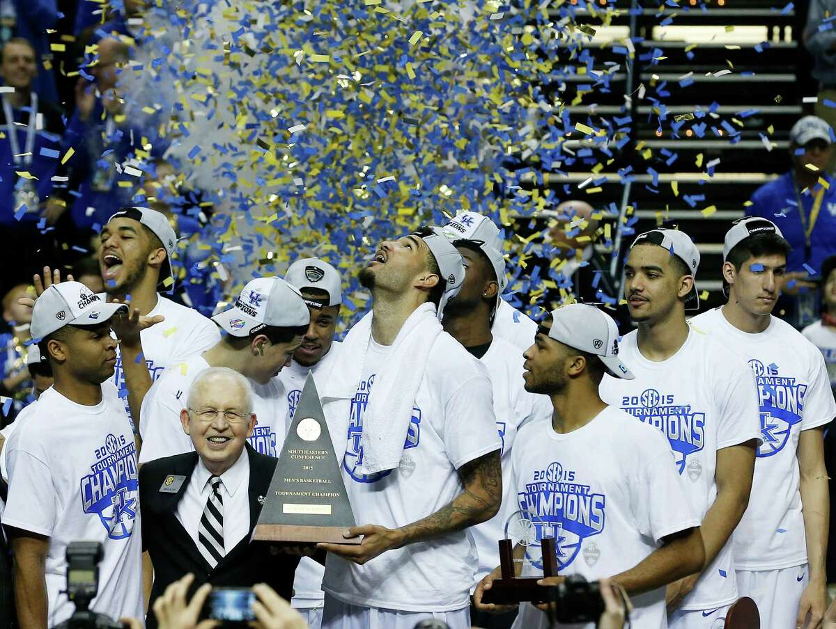 Kentucky forward Willie Cauley-Stein holds the trophy after the NCAA college basketball Southeastern Conference tournament championship game against Arkansas, Sunday, March 15, 2015, in Nashville, Tenn. Kentucky won 78-63. (AP Photo/Steve Helber) ORG XMIT: TNMS170