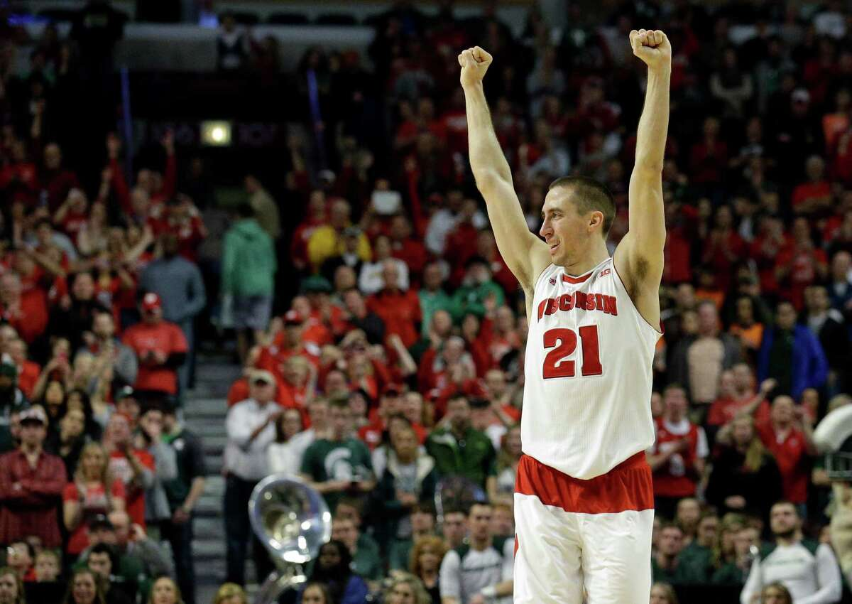 Wisconsin's Josh Gasser (21) celebrates in the second half of an NCAA college basketball game in the championship of the Big Ten Conference tournament in Chicago, Sunday, March 15, 2015. Wisconsin defeated Michigan State 80-69 in overtime. (AP Photo/Nam Y. Huh) ORG XMIT: ILMC124