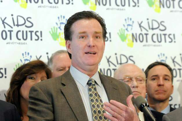 Sen. John Flanagan, center, calls for a budget that returns $1 billion to schools by ending the Gap Elimination Adjustment during a news conference on Tuesday, Feb. 10, 2015, at the Capitol in Albany, N.Y. (Cindy Schultz / Times Union) Photo: Cindy Schultz / 00030538A