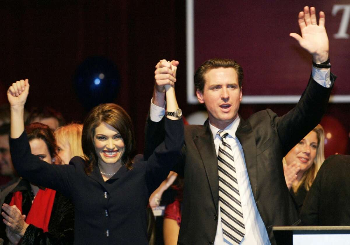 San Francisco Mayor-elect Gavin Newsom and his wife Kimberly Guilfoyle Newsom acknowledge their supporters at a victory party after Newsom's opponent, Green party candidate Matt Gonzalez, conceded in San Francisco, December 9, 2003.