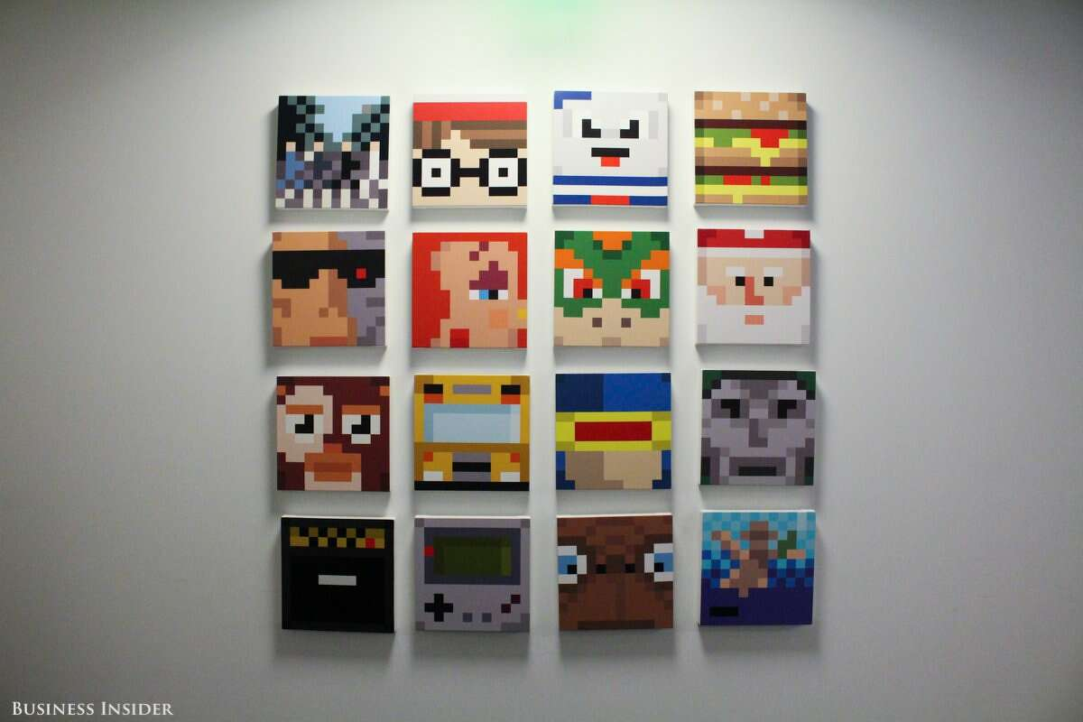 At the end of the hall, a gallery wall displays works of