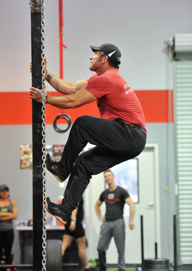 """Vance Yarter goes through an """"American Ninja Warrior"""" style training session at Power Park Fitness in Spring Branch. Photo: Robin Jerstad /San Antonio Express-News"""
