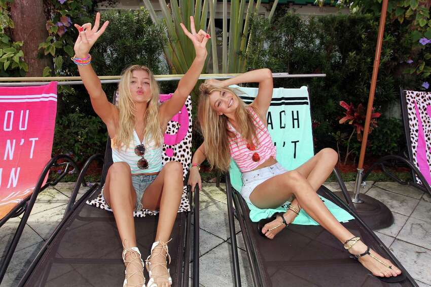 L-R) Victoria's Secret PINK models Rachel Hilbert and Gigi Hadid attend the Ultimate Spring Break Bash hosted by Victoria's Secret PINK Nation at Surfcomber Miami, South Beach on March 14, 2015 in Miami Beach, Florida.