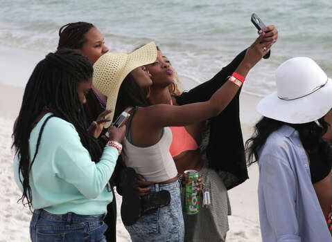 College students take selfies during the first week of Spring Break on Friday, March 6, 2015, in Panama City Beach, Fla. Photo: Heather Leiphart, AP / The Panama City News Herald