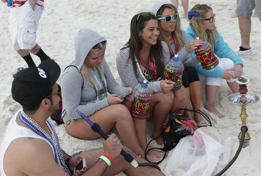 College students party on the beach during the first week of Spring Break on Friday, March 6, 2015, in Panama City Beach, Fla. Photo: Heather Leiphart, AP / The Panama City News Herald