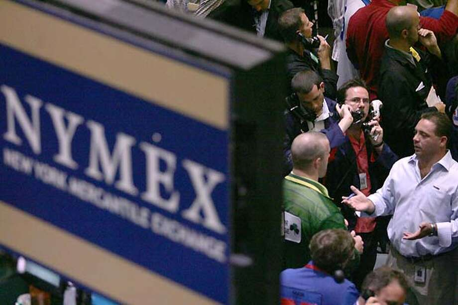 Oil traders work the floor at the New York Mercantile Exchange in this undated file photo. Photo: MARY ALTAFFER, ASSOCIATED PRESS / AP2006