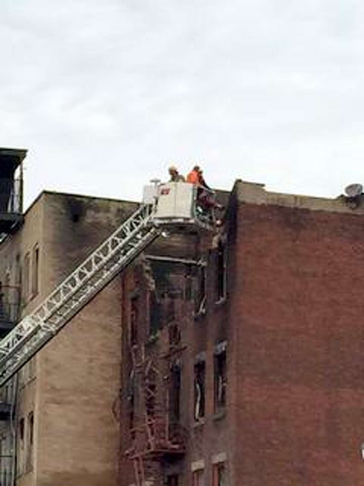 Crews photographing on Monday, March 16, 2015, inside a building destroyed by a fire on Jay Street earlier this month. (Dartunorro D. Clark/Times Union)