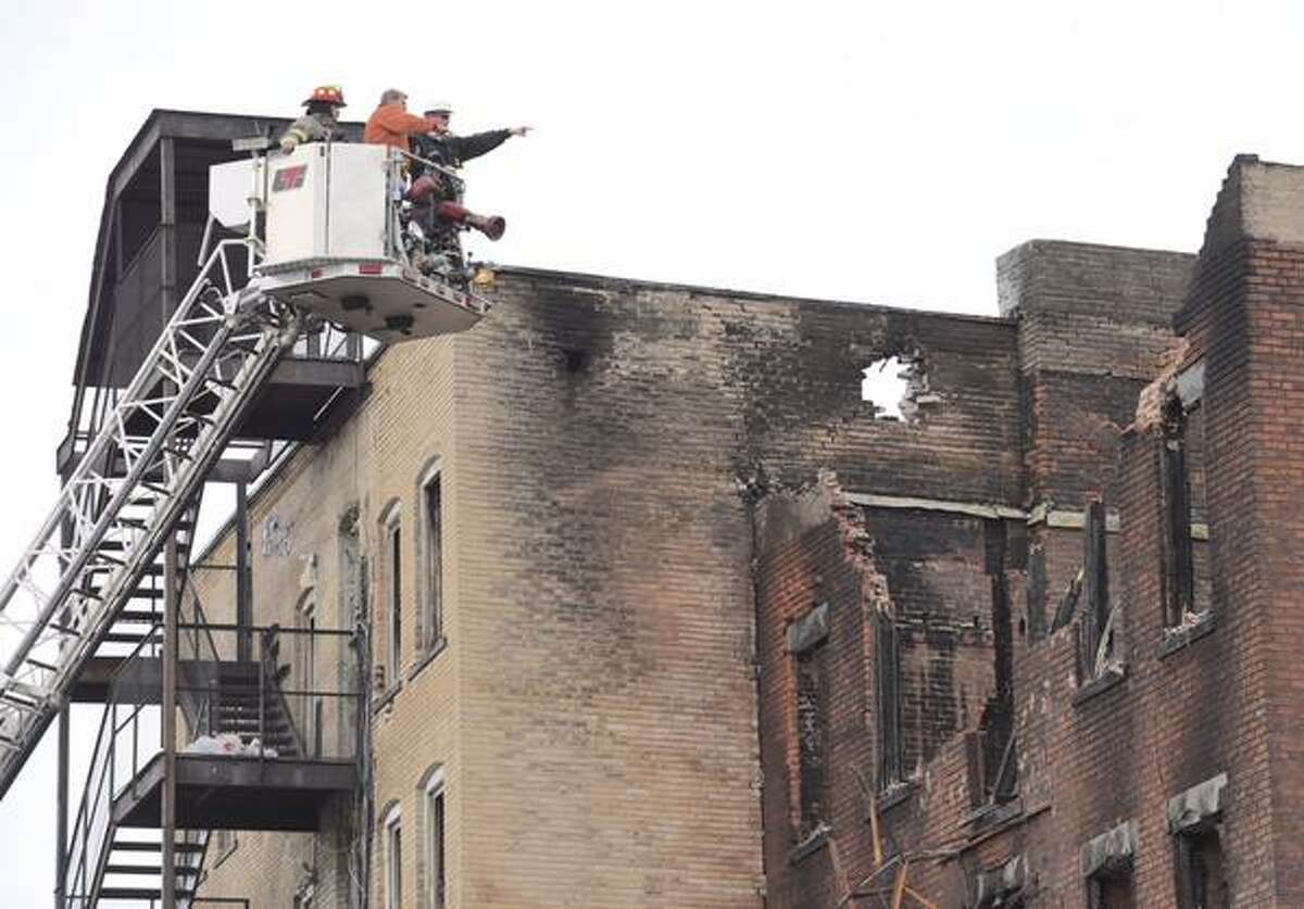 Schenectady Building Inspector Eric Schilling points toward 104 Jay St during an aerial look at the fire scene on Monday, March 16, 2015. (Skip Dickstein/Times Union)
