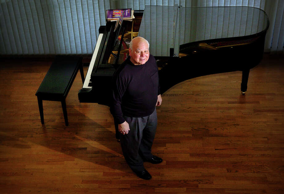 Robert Genualdi stands beside a piano in his Black Rock, Conn.home on Thursday, May 3. 2007. Genualdi was the music director and conductor for the Greater Bridgeport Youth Orchestra for 26 years. Genualdi died Saturday March, 14, 2015 following a short illness. He was 84. Photo: John Galayda, John Galayda/file Photo / Connecticut Post