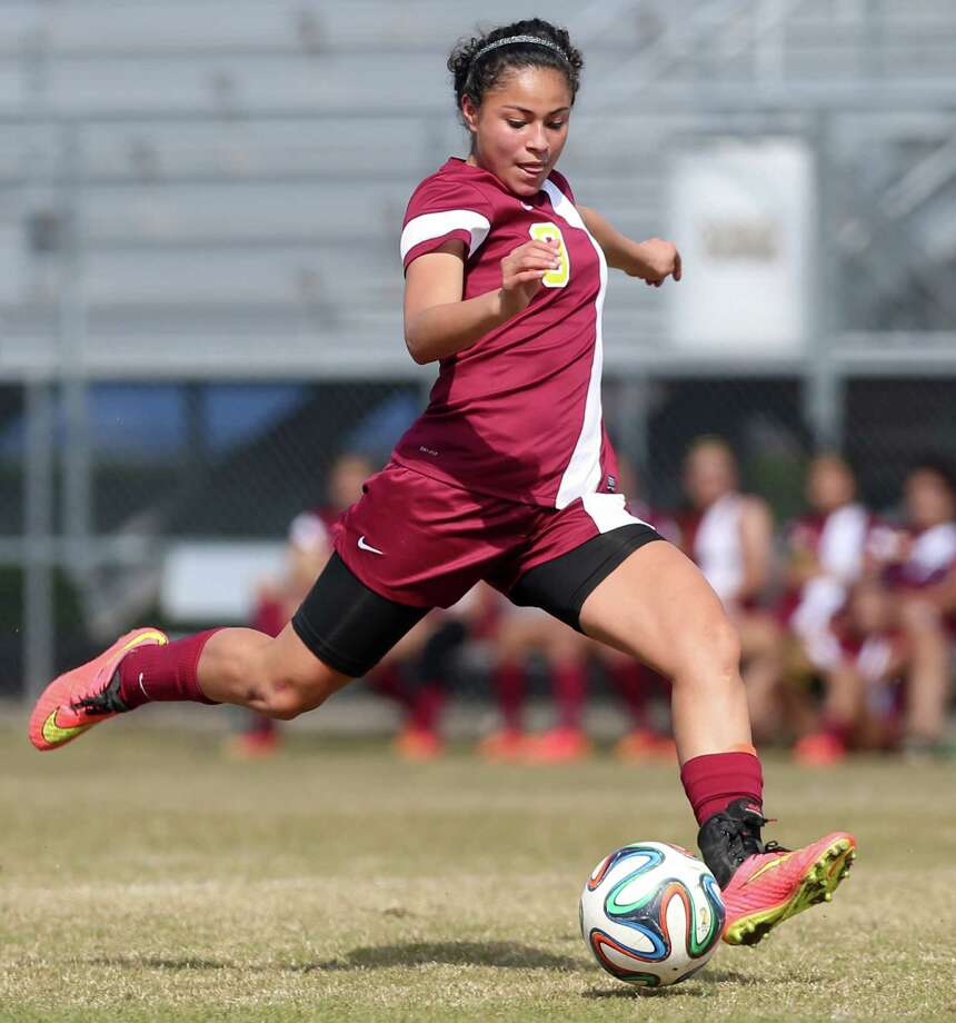Harlandale's Ingrid Garcia prepares to score her third goal during their game with Lanier at the SAISD Sports Complex on Tuesday, March 10, 2015.  Garcia scored four goals in the game to help the Lady Indians beat Lanier 5-1 and remain undefeated on the season at 16-0.  MARVIN PFEIFFER/ mpfeiffer@express-news.net Photo: Marvin Pfeiffer, Staff / San Antonio Express-News / Express-News 2015