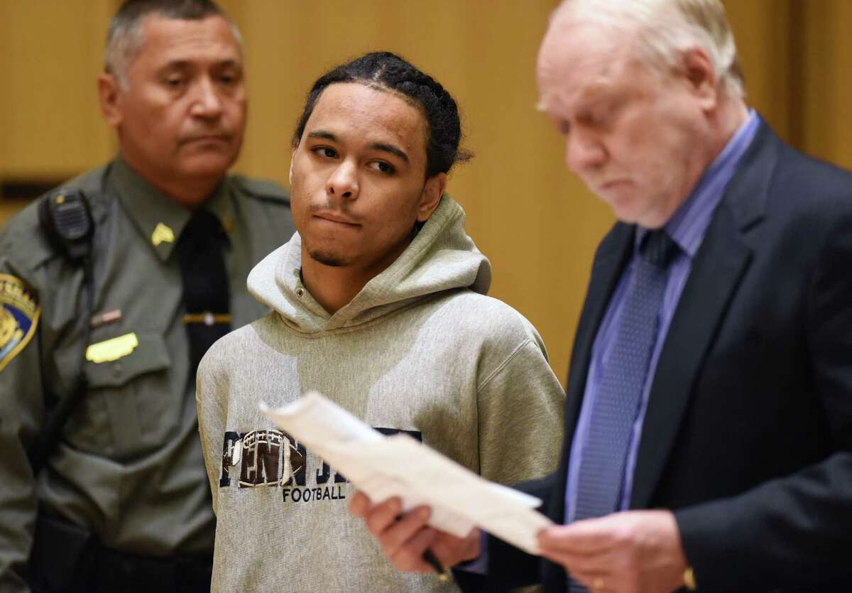James McLamb, center, 22, of Harding Place, New Haven, is arraigned at the Connecticut Superior Court in Stamford, Conn. Monday, March 16, 2015. McLamb was charged for the murder of Antonio Muralles, who was stabbed on Bedford Street Wednesday night. A 15-year-old juvenile was also charged with murder.