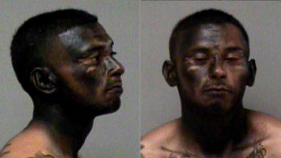 Jose Espinoza's police booking shot what appears to be paint on his face. Photo: Madera County Jail