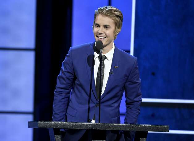 Justin Bieber speaks at the Comedy Central Roast of Justin Bieber at Sony Pictures Studios on Saturday, March 14, 2015, in Culver City, Calif. (Photo by Chris Pizzello/Invision/AP) Photo: Chris Pizzello, Associated Press