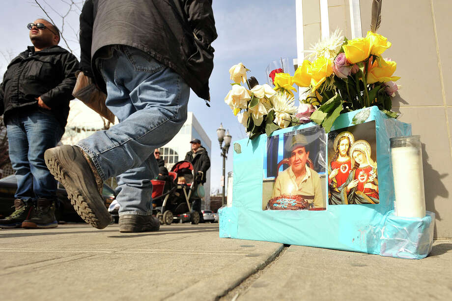 A memorial to Antonio Muralles sits on the corner Monday, March 16, 2015, outsied the McDonalds where he was murdered last Wednesday night in Stamford, Conn. Photo: Jason Rearick / Stamford Advocate