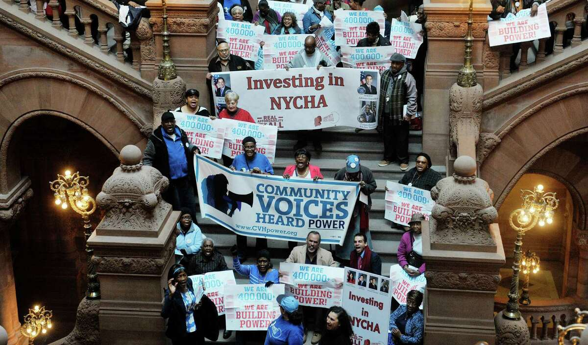 Public housing residents and advocates for public housing take part in a rally on the steps of the Million Dollar Staircase on Monday, March 16, 2015, in Albany, N.Y. The groups were asking for money funding for public housing in the budget. (Paul Buckowski / Times Union)