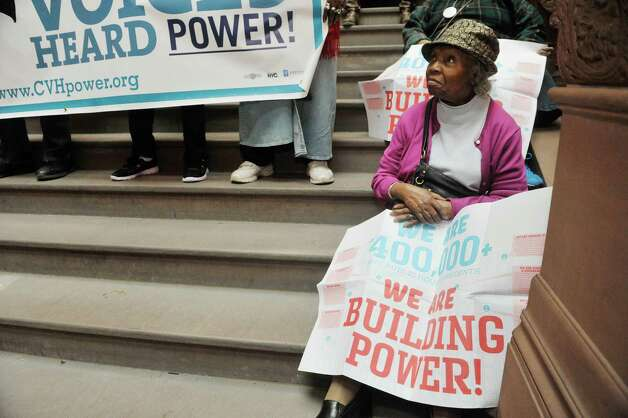 Eartha M. Coker, a resident of Lincoln Houses in Manhattan, takes part in a rally held by public housing residents and advocates for public housing on the steps of the Million Dollar Staircase on Monday, March 16, 2015, in Albany, N.Y.   (Paul Buckowski / Times Union) Photo: PAUL BUCKOWSKI / 00031048A