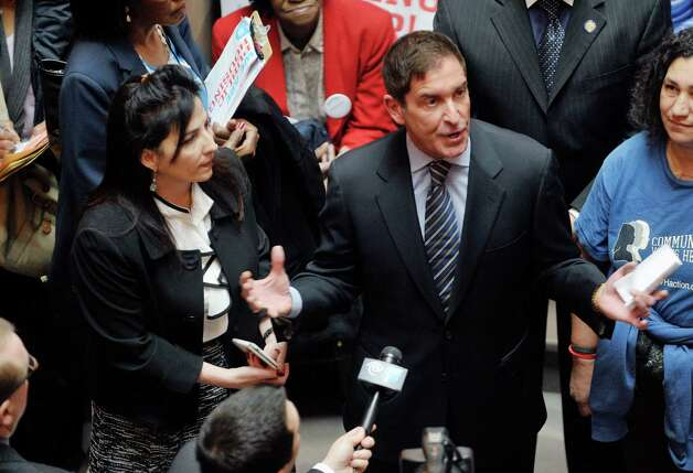 Senator Diane Savino, left, and Senator Jeff Klein take part in a rally held by public housing residents and advocates for public housing on the steps of the Million Dollar Staircase on Monday, March 16, 2015, in Albany, N.Y.  (Paul Buckowski / Times Union) Photo: PAUL BUCKOWSKI / 00031048A