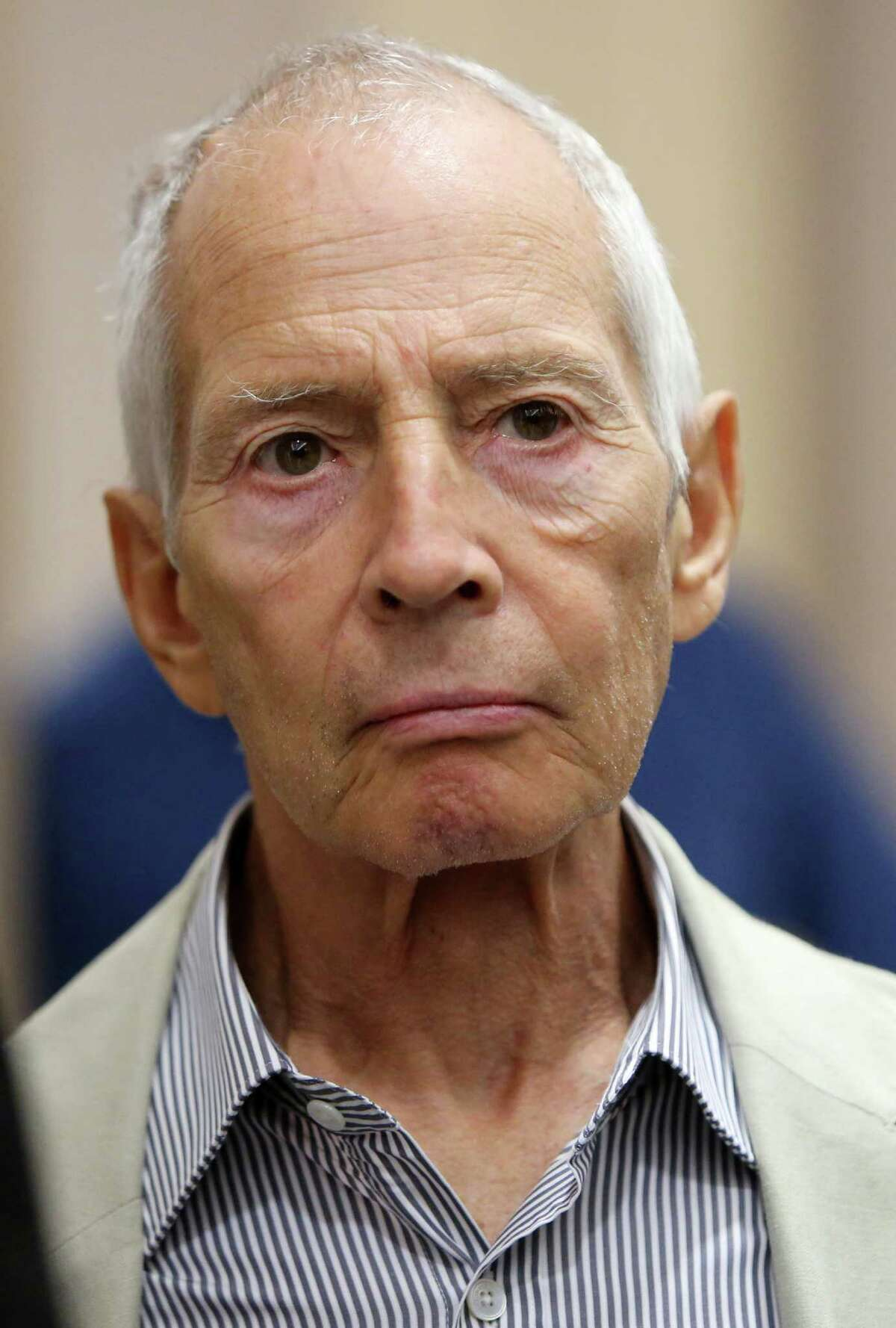 Robert Durst walks out of court at the Harris County Criminal Justice Center on Friday, Aug. 15, 2014, in Houston, TX. The complex and bloody trail of Robert Durst seemed to come to an end Sunday with the apparent off-camera admission on the HBO true-crime show
