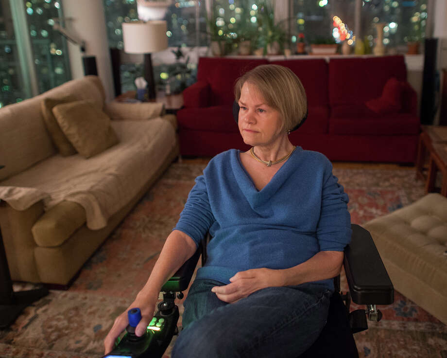 Sara Myers at home in her Manhattan apartment, Monday, February 2, 2015. She has ALS is plaintiff in a lawsuit to force New York to allow doctors to help terminally ill patients die. Photo: Joshua Bright,  Joshua Bright For The New York / 50/50 © Joshua Bright/The New York Times Connecticut Post contributed