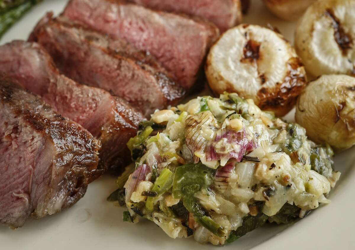 Grilled New York Steak With Spring Onion Relish, Asparagus & Baby Turnips is seen on Tuesday, March 10, 2015 in San Francisco, Calif. Grilled New York Steak With Spring Onion Relish, Asparagus & Baby Turnips is seen on Tuesday, March 10, 2015 in San Francisco, Calif. ***MANDATORY CREDIT FOR PHOTOGRAPHER AND SAN FRANCISCO CHRONICLE***/NO SALES--MAGS OUT--TV OUT--BAY AREA NEWS GROUP OUT