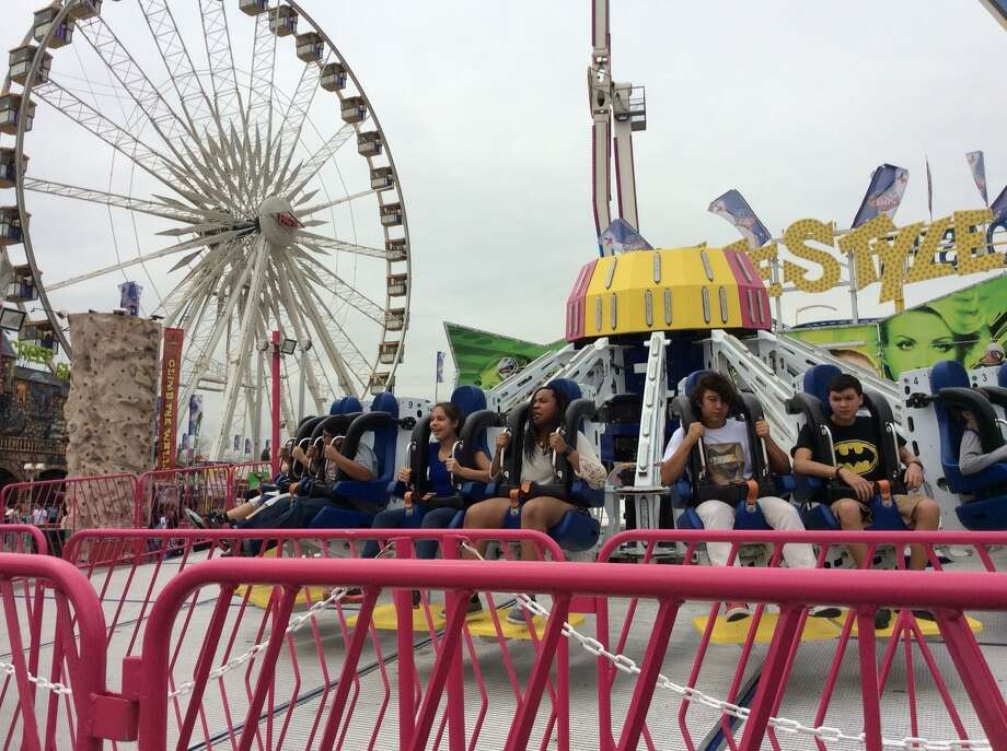Warm weather finally arrived at the Houston Livestock Show and Rodeo midway just in time for families to enjoy spring break on March 16, 2015. Photo: Mike Glenn | Houston Chronicle