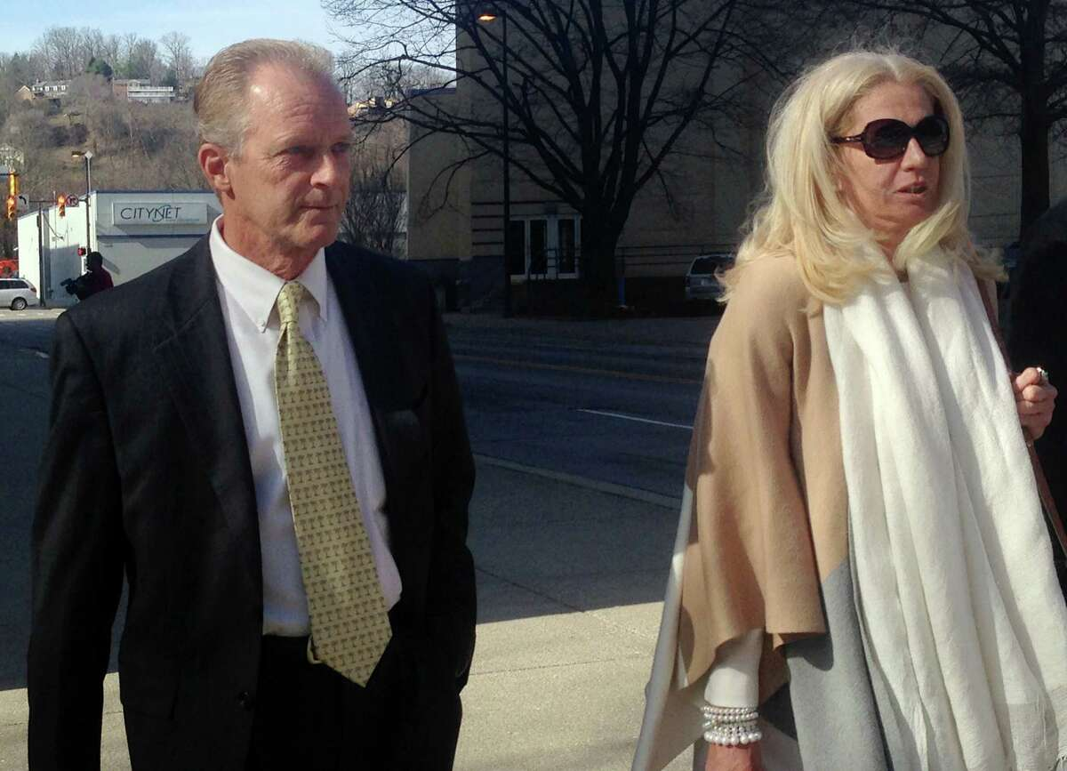 Former Freedom Industries owner William Tis, left, walks with his attorney, Kathleen Gallagher, as they leave U.S. District Court in Charleston, W.Va., Monday, March 16, 2015. Tis pleaded guilty Monday to a federal Clean Water Act violation stemming from a January 2014 chemical spill from Freedom Industries into a river that contaminated the local drinking water supply for days.