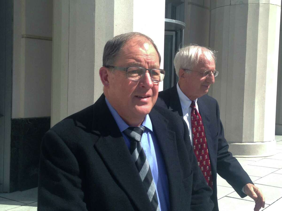 Charles Herzing, left, and his attorney, Steve Jory, leave U.S. District Court in Charleston, W.Va., on Monday, March 16, 2015, after Herzing pleaded guilty to an environmental violation for a January 2014 chemical spill that contaminated a river and prompted a tap water ban for 300,000 residents for days.