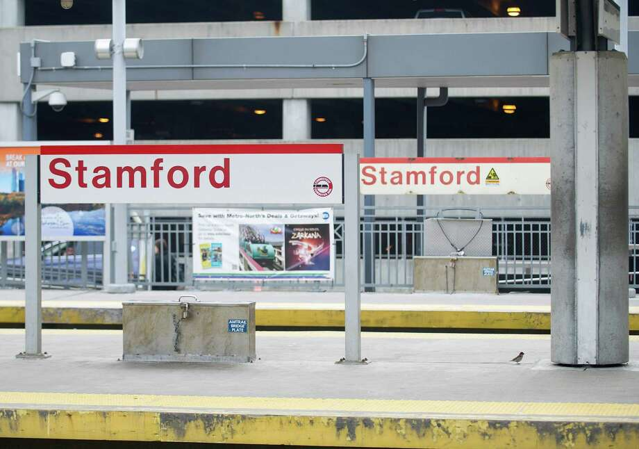 Stamford train station with garage that is to be replaced with a development planned to have retail, residential, commercial and a hotel included in it. Photo: Lindsay Perry / Stamford Advocate