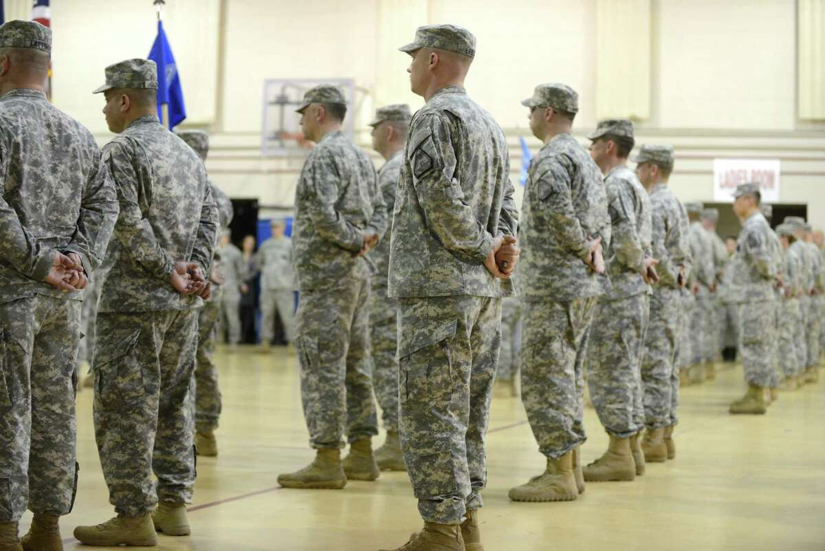 New York Army National Guard soldiers listen to speeches during a change of command ceremony Monday, March 16, 2015, at the State Division of Military and Naval Affairs headquarters in Colonie, N.Y. Lt. Col. James Gonyo took command of the New York Army National Guard Recruiting and Retention Battalion from Lt. Col. Henry Pettit. (Will Waldron/Times Union)