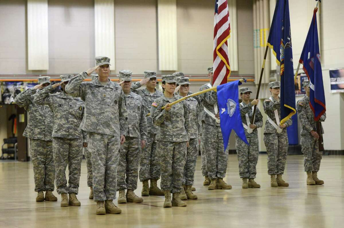 New York Army National Guard soldiers salute during a change of command ceremony Monday, March 16, 2015, at the State Division of Military and Naval Affairs headquarters in Colonie, N.Y. Lt. Col. James Gonyo took command of the New York Army National Guard Recruiting and Retention Battalion from Lt. Col. Henry Pettit. (Will Waldron/Times Union)