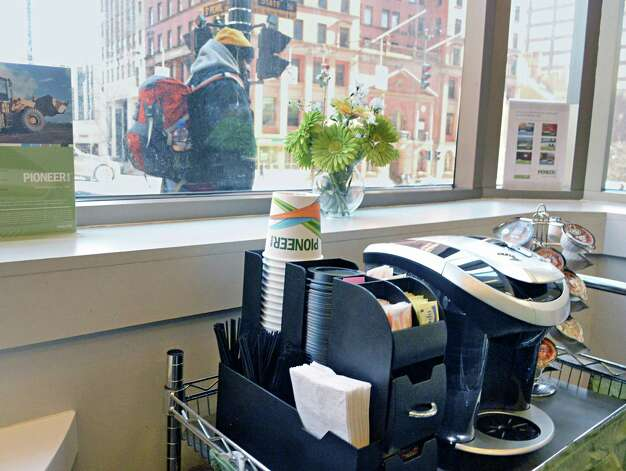 Customer coffee station inside the Pioneer Bank branch at 90 State Street Thursday March 12, 2015 in Albany, NY.  (John Carl D'Annibale / Times Union) Photo: John Carl D'Annibale / 00030794A
