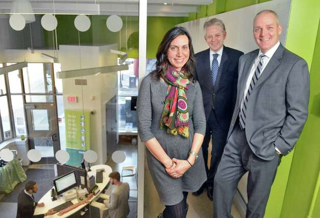Tina Mesiti-Ceas, left, of CS Arch poses with bank president Thomas Amell, right and executive vice president Frank Sarratori inside the Pioneer Bank branch at 90 State Street Thursday March 12, 2015 in Albany, NY.  (John Carl D'Annibale / Times Union) Photo: John Carl D'Annibale / 00030794A