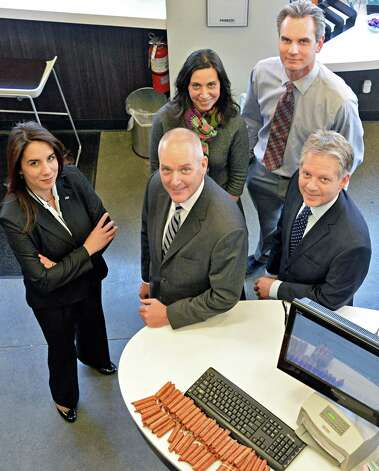 From left:  Pioneer's market leader Sheila Viera, bank president Thomas Amell, CS Arch's Tina Mesiti-Ceas and Gregory Klkiw and bank executive vice president Frank Sarratori inside the Pioneer Bank branch at 90 State Street Thursday March 12, 2015 in Albany, NY.  (John Carl D'Annibale / Times Union) Photo: John Carl D'Annibale / 00030794A