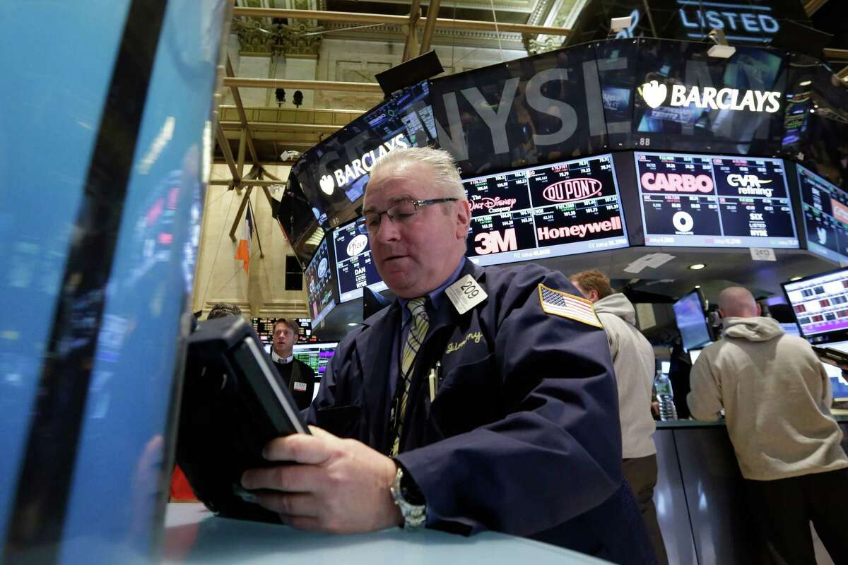 Trader James Dresch works on the floor of the New York Stock Exchange, Monday, March 16, 2015. U.S. stocks opened higher, led by health care and utilities companies, rebounding after three weeks of losses. (AP Photo/Richard Drew) ORG XMIT: NYRD103