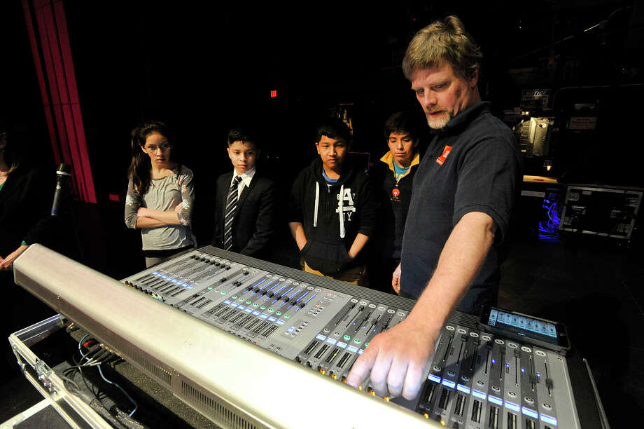 Erik Putz, right, sound head for the Palace Theatre, shows how a digital mixing board works to music students from INTAKE from left: Mariel Balderrama, Alek Bahena, Bryan Lojano and Glenn Cavero during the INTAKE organization's education session with people from audio equipment manufacturer Harman at the Palace Theatre in Stamford, Conn., on Monday, March 16, 2015. The students played their instruments while getting a taste of using top-of-the-line audio recording equipment. The students also met the head of Harman, Dinesh Paliwal. Photo: Jason Rearick / Stamford Advocate
