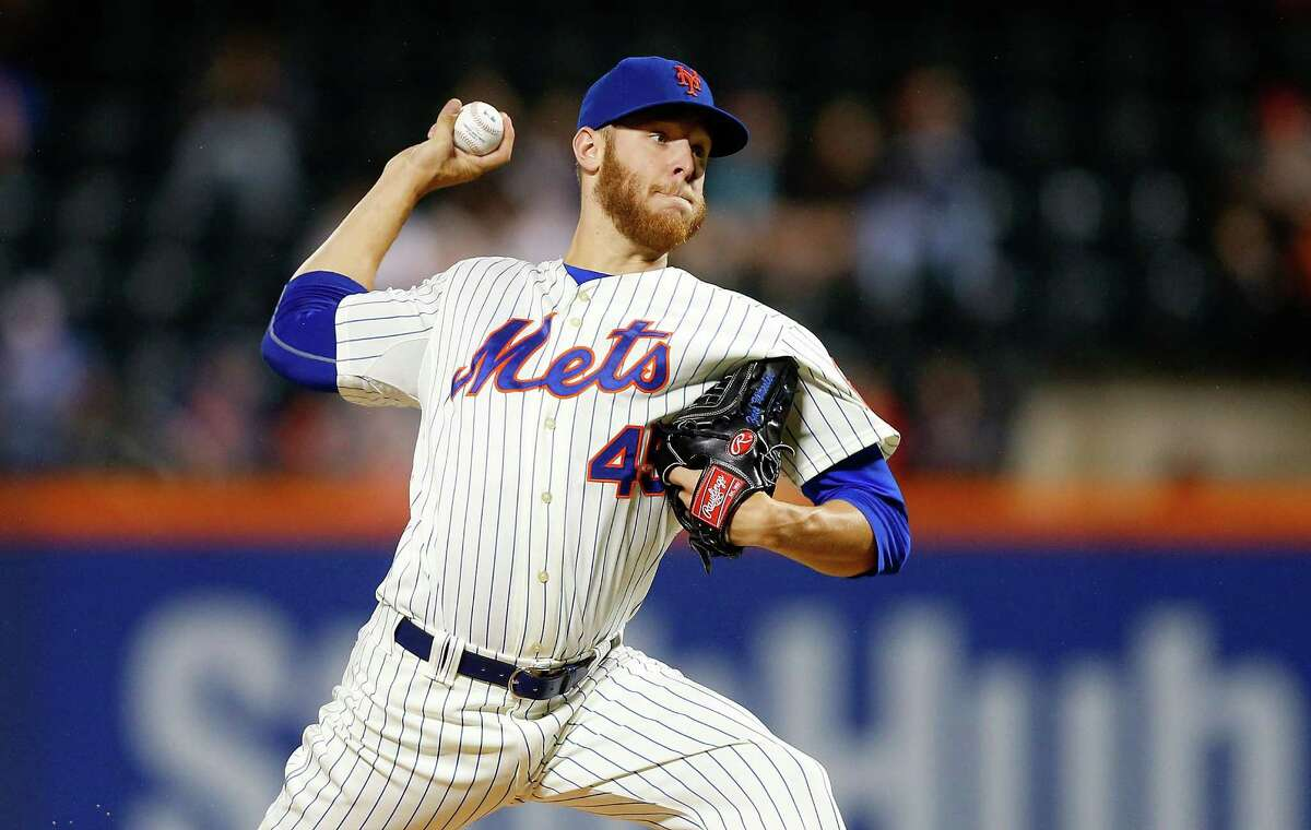 NEW YORK, NY - SEPTEMBER 13: Zack Wheeler #45 of the New York Mets pitches in the third inning against the Washington Nationals at Citi Field on September 13, 2014 in the Flushing neighborhood of the Queens borough of New York City. (Photo by Jim McIsaac/Getty Images) ORG XMIT: 477589883