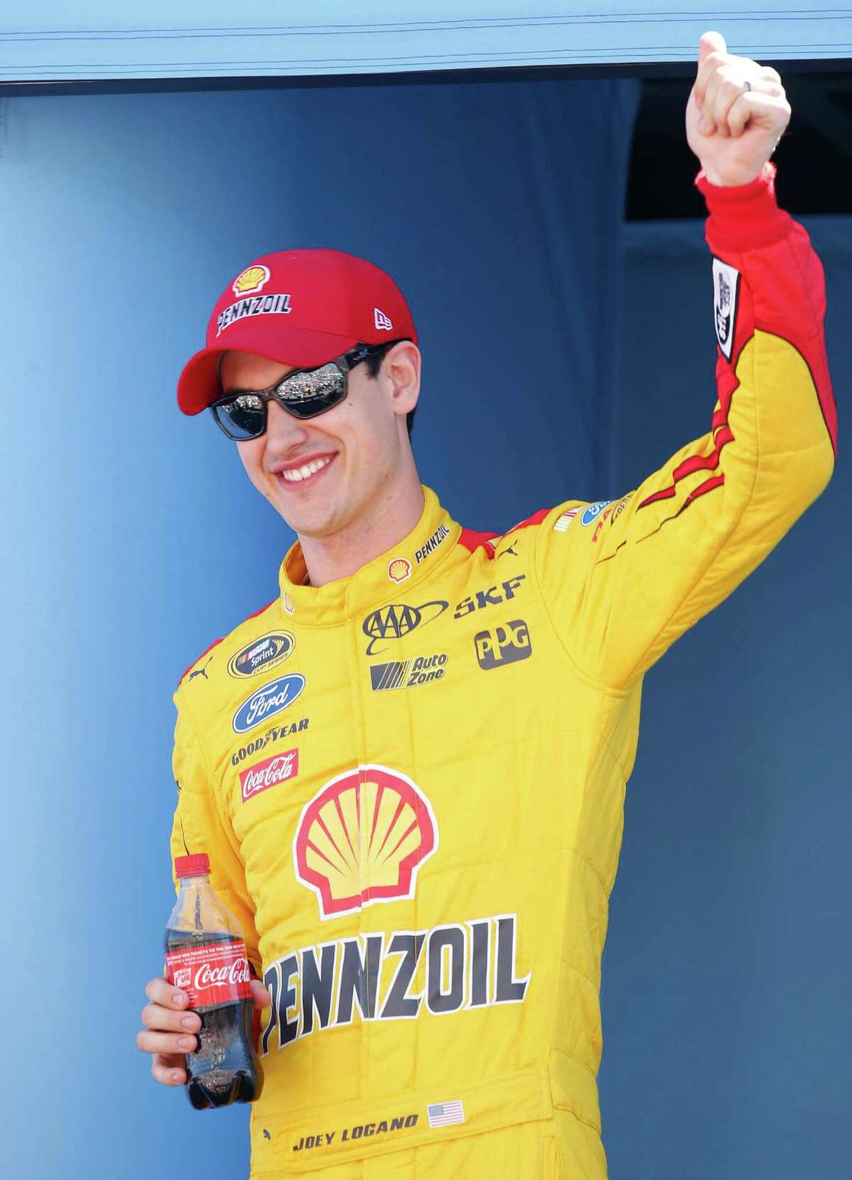 Joey Logano waves to the fans before a NASCAR Sprint Cup Series auto race on Sunday, March 15, 2015, in Avondale, Ariz. (AP Photo/Rick Scuteri) ORG XMIT: AZRS107