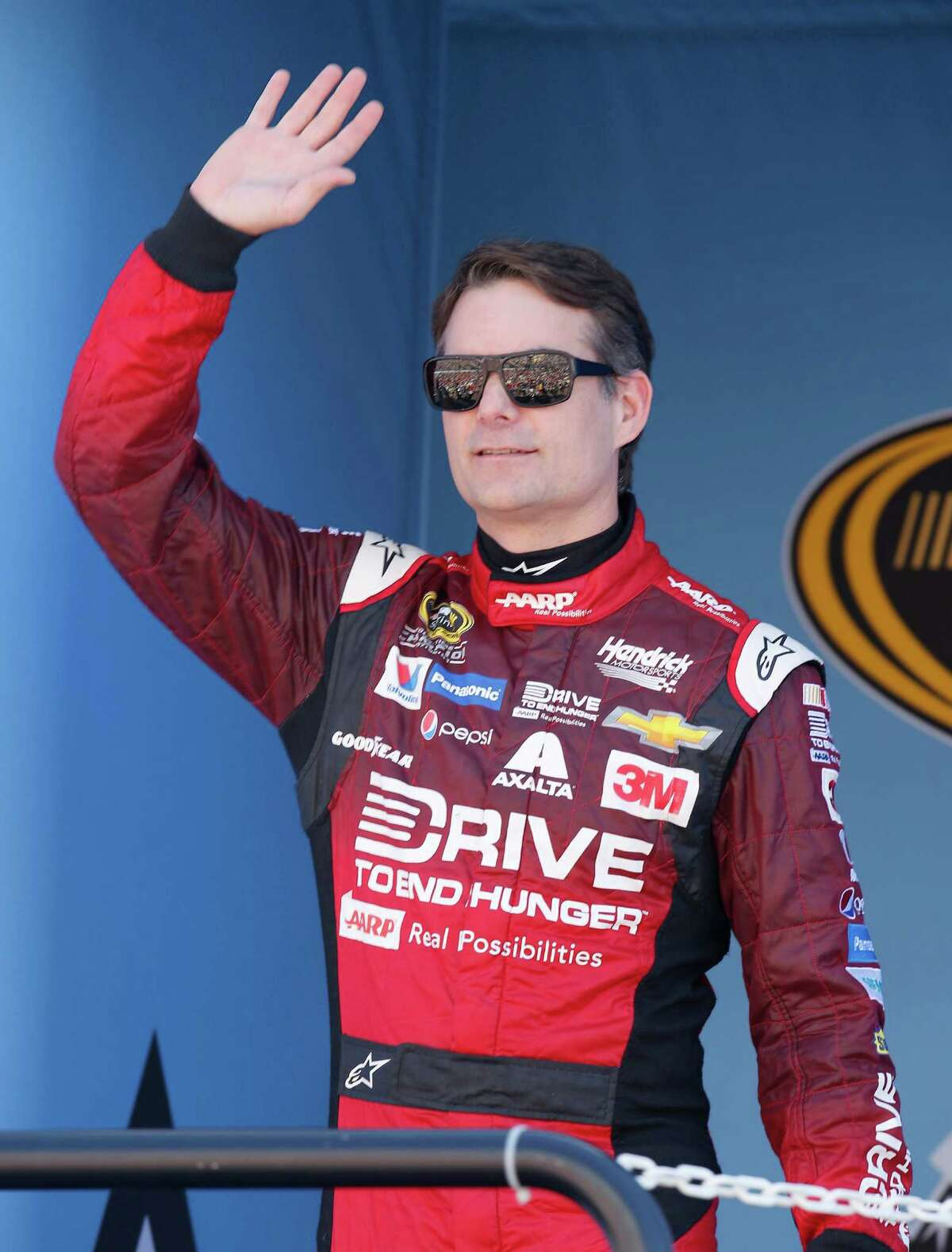 Jeff Gordon waves to the fans before a NASCAR Sprint Cup Series auto race on Sunday, March 15, 2015, in Avondale, Ariz. (AP Photo/Rick Scuteri) ORG XMIT: AZRS109