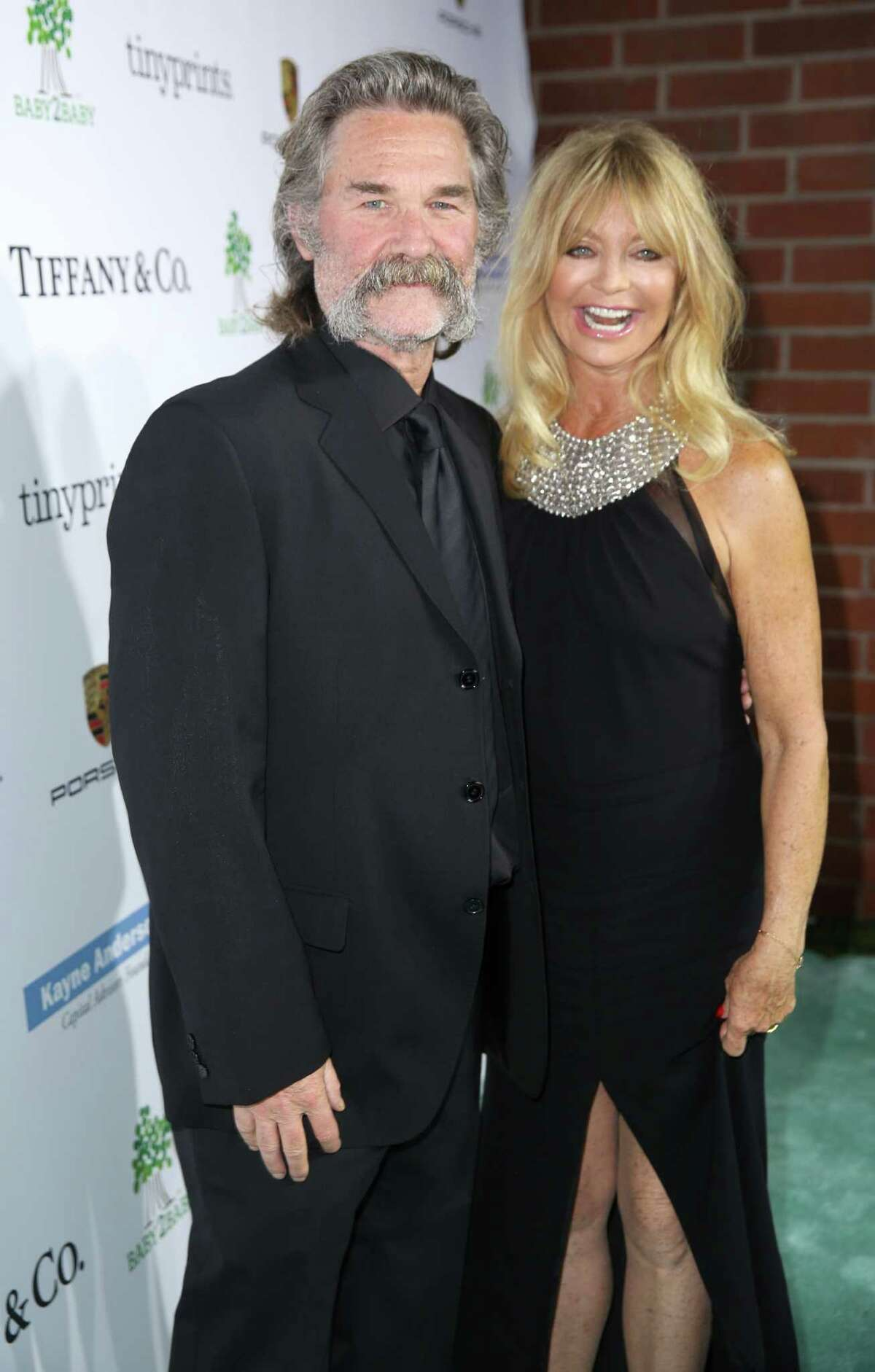 Kurt Russell, left, and Goldie Hawn arrive at the Third annual Baby2Baby Gala honoring Kate Hudson at The Book Bindery on Saturday, Nov. 8, 2014, in Culver City, Calif. (Photo by Matt Sayles/Invision/AP) ORG XMIT: CABR117