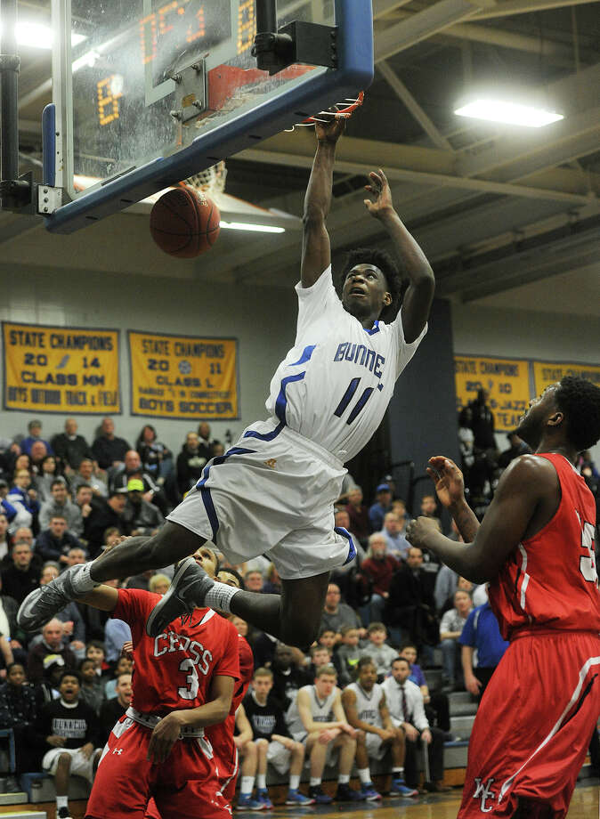 Bunnell's Aaron Samuel dunks the ball during the second half of the Bulldogs' victory over Wilbur Cross in the Class L quarterfinals of the state boys basketball tournament at Bunnell High School in Stratford, Conn. on Monday, March 16, 2015. Photo: Brian A. Pounds / Connecticut Post