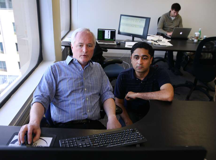 """Founder and CEO James Crawford (left) collaborates with senior software developer Nitin Panjwani at the Orbital Insight office in Mountain View, Calif. on Friday, March 13, 2015. The start-up uses satellite imagery to, according to its website, detail """"global and national trends through advanced image processing and data science."""" Photo: Paul Chinn, The Chronicle"""
