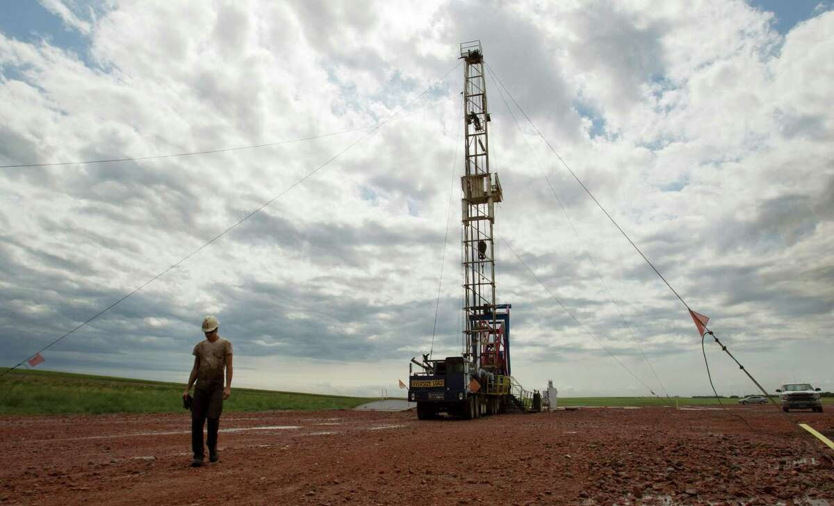 U.S. oil production is continuing to grow, even as companies are idling drilling rigs. (AP Photo/Gregory Bull, File)