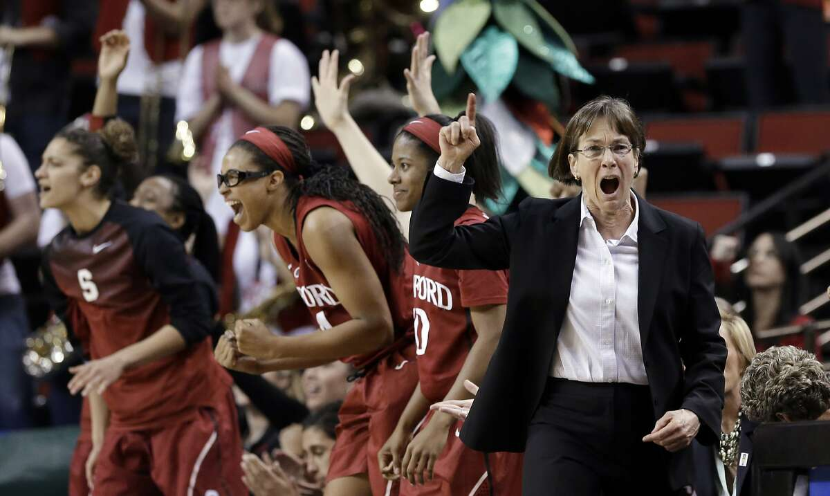 Stanford coach Tara VanDerveer lets out a yell as her bench reacts behind on a free throw made by the team against Arizona State in the final seconds of an NCAA college basketball game in the semifinals of the Pac-12 Conference tournament Saturday, March 7, 2015, in Seattle. Stanford won 59-56. (AP Photo/Elaine Thompson)
